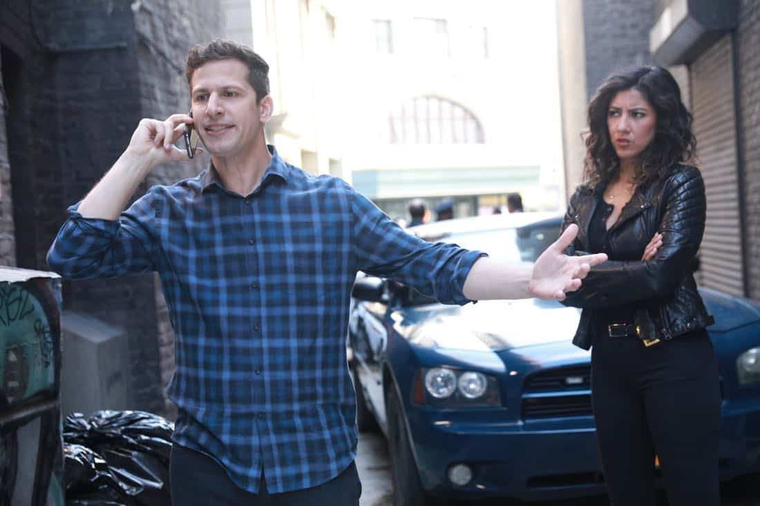 "BROOKLYN NINE-NINE: L-R: Andy Samberg and Stephanie Beatriz in the ""The Negotiation"" episode of BROOKLYN NINE-NINE airing Sunday, March 25 (8:30-9:00 PM ET/PT) on FOX. CR: FOX"