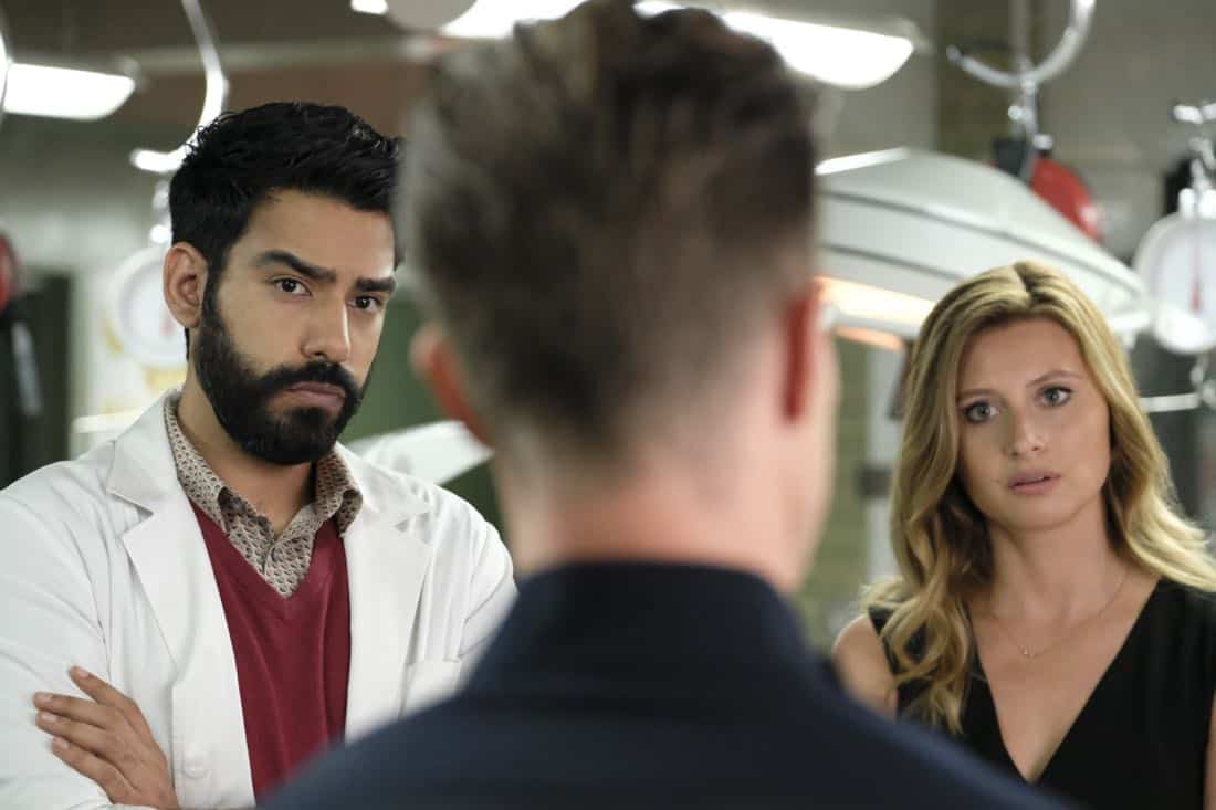 "iZombie -- ""Goon Struck"" -- Image Number: ZMB405a_0127.jpg -- Pictured (L-R): Rahul Kohli as Ravi, Jason Dohring as Chase Graves and Aly Michalka as Peyton -- Photo: Bettina Strauss/The CW --  © 2018 The CW Network, LLC. All rights reserved."