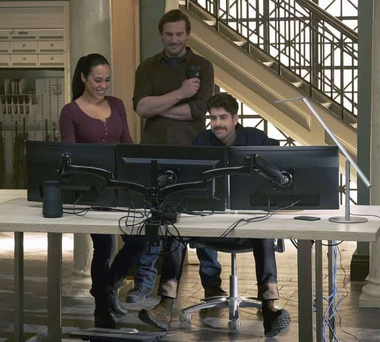 "TAKEN -- ""Verum Nocet"" Episode 209 -- Pictured: (l-r) Jessica Camacho as Santana, Clive Standen as Bryan Mills, Adam Goldberg as Kilroy -- (Photo by: Christos Kalohoridis/NBC)"
