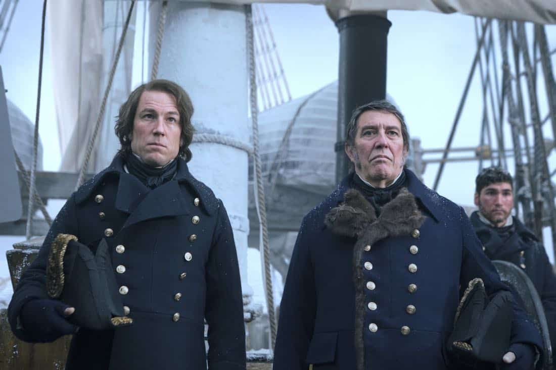 Tobias Menzies as James Fitzjames, Ciarán Hinds as John Franklin - The Terror _ Season 1, Episode 1 - Photo Credit: Aidan Monaghan/AMC