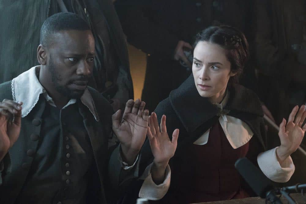 "TIMELESS -- ""The Salem Witch Hunt"" Episode 204 -- Pictured: (l-r) Michael Barrett as Rufus Carlin, Abigail Spencer as Lucy Preston -- (Photo by: Patrick Wymore/NBC)"