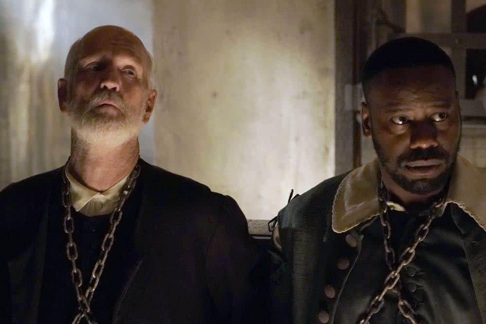 """TIMELESS -- """"The Salem Witch Hunt"""" Episode 204 -- Pictured: (l-r) David Wells as Prisoner/Wardwell Michael Barrett as Rufus Carlin -- (Photo by: Chris Haston/NBC)"""