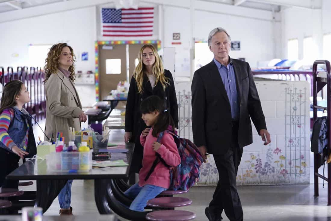 """The Numerical Limit"" -- Gibbs is granted protective custody of a 10-year-old orphaned refugee, Elena (Lily Rose Silver), when an NCIS case reveals she is the target of a violent gang, on NCIS, Tuesday, April 3 (8:00-9:00 PM, ET/PT) on the CBS Television Network. Pictured: Alexis Carra, Emily Wickersham, Mark Harmon Photo: Sonja Flemming/CBS ©2018 CBS Broadcasting, Inc. All Rights Reserved"