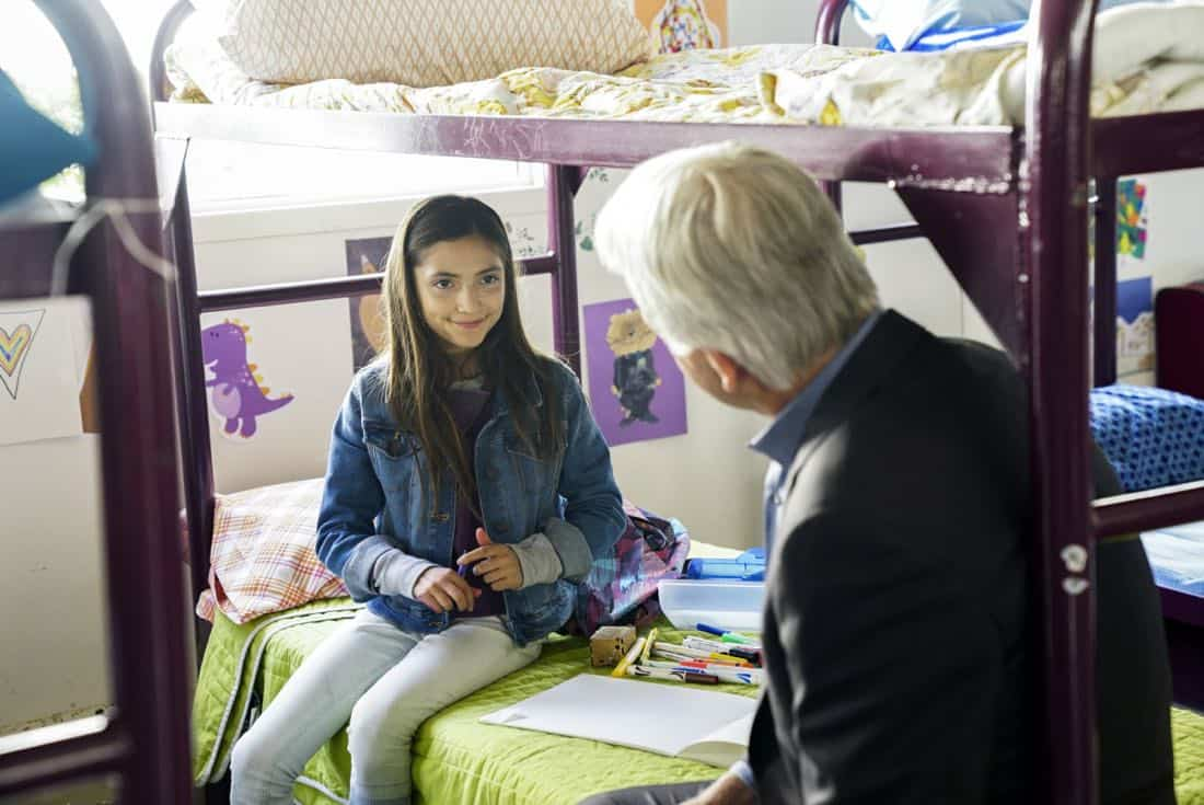 """The Numerical Limit"" -- Gibbs is granted protective custody of a 10-year-old orphaned refugee, Elena (Lily Rose Silver), when an NCIS case reveals she is the target of a violent gang, on NCIS, Tuesday, April 3 (8:00-9:00 PM, ET/PT) on the CBS Television Network. Pictured: Lily Rose Silver, Mark Harmon Photo: Sonja Flemming/CBS ©2018 CBS Broadcasting, Inc. All Rights Reserved"