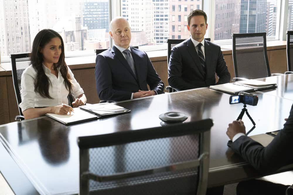 "SUITS -- ""Bad Man"" Episode 712 -- Pictured: (l-r) Meghan Markle as Rachel Zane, Patrick J. Adams as Mike Ross -- (Photo by: Ian Watson/USA Network)"