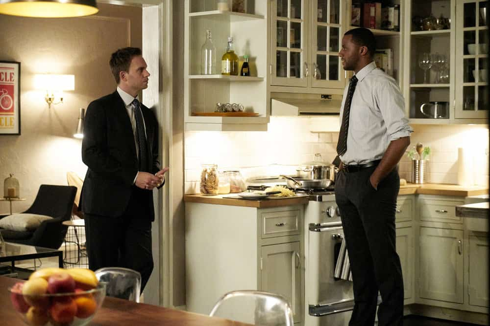 "SUITS -- ""Bad Man"" Episode 712 -- Pictured: (l-r) Patrick J. Adams as Mike Ross, Jordan Johnson-Hinds as Oliver Grady -- (Photo by: Ian Watson/USA Network)"