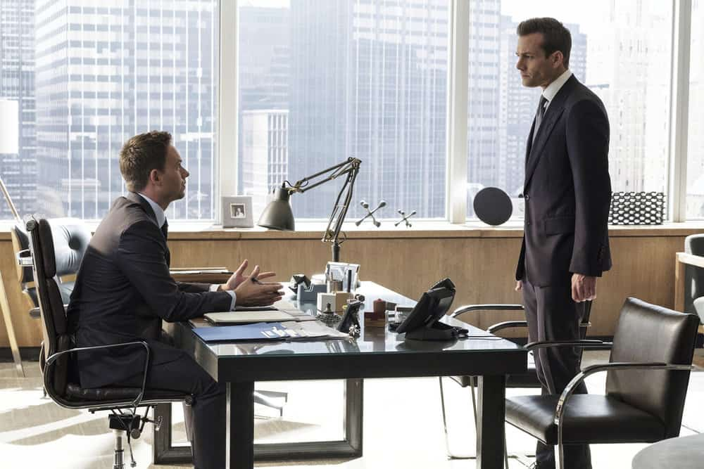 "SUITS -- ""Bad Man"" Episode 712 -- Pictured: (l-r) Patrick J. Adams as Mike Ross, Gabriel Macht as Harvey Specter -- (Photo by: Christos Kalohoridis/USA Network)"