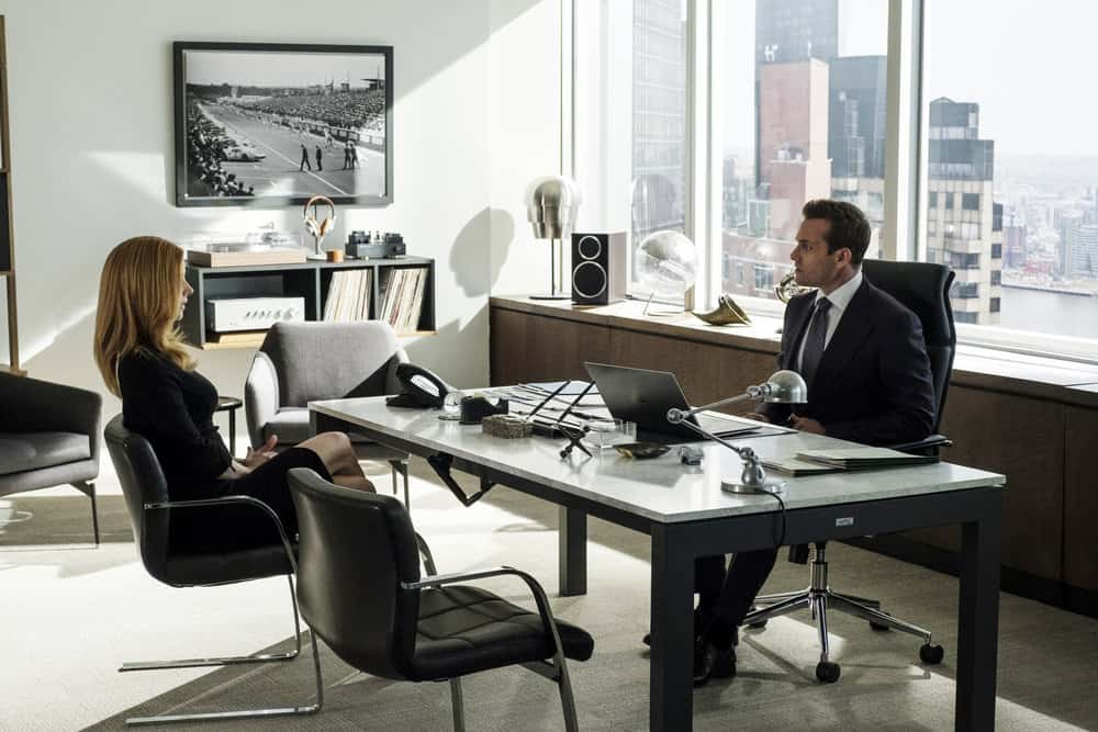 "SUITS -- ""Bad Man"" Episode 712 -- Pictured: (l-r) Sarah Rafferty as Donna Paulsen, Gabriel Macht as Harvey Specter -- (Photo by: Christos Kalohoridis/USA Network)"