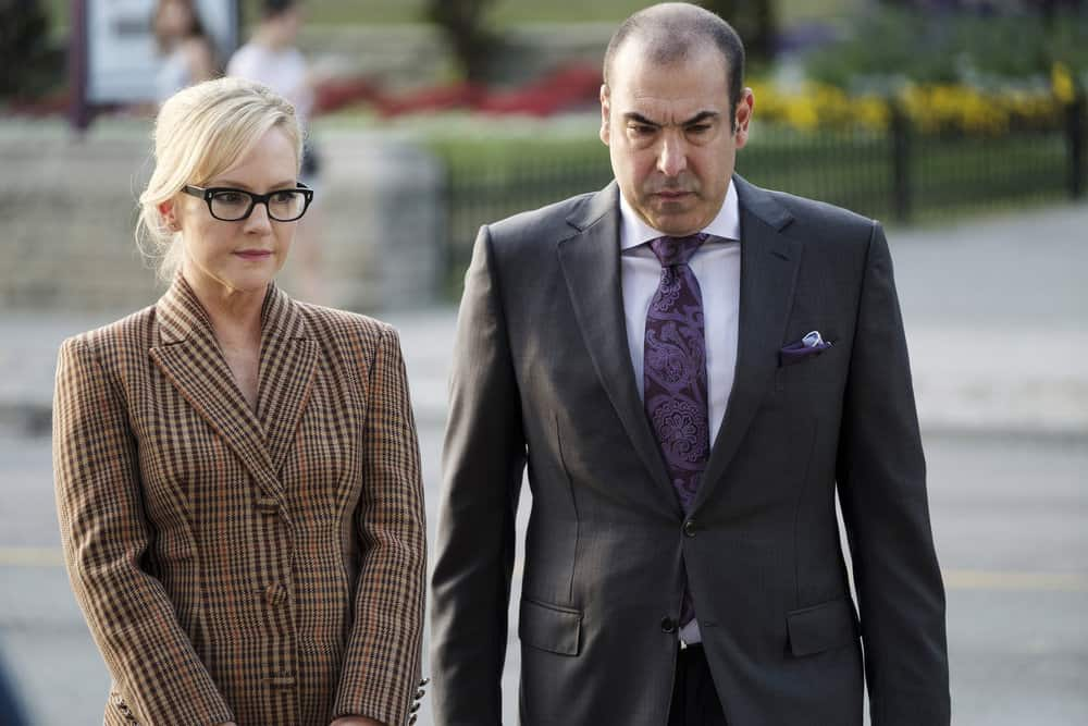 "SUITS -- ""Bad Man"" Episode 712 -- Pictured: (l-r) Rachael Harris as Sheila Sazs, Rick Hoffman as Louis Litt -- (Photo by: Christos Kalohoridis/USA Network)"