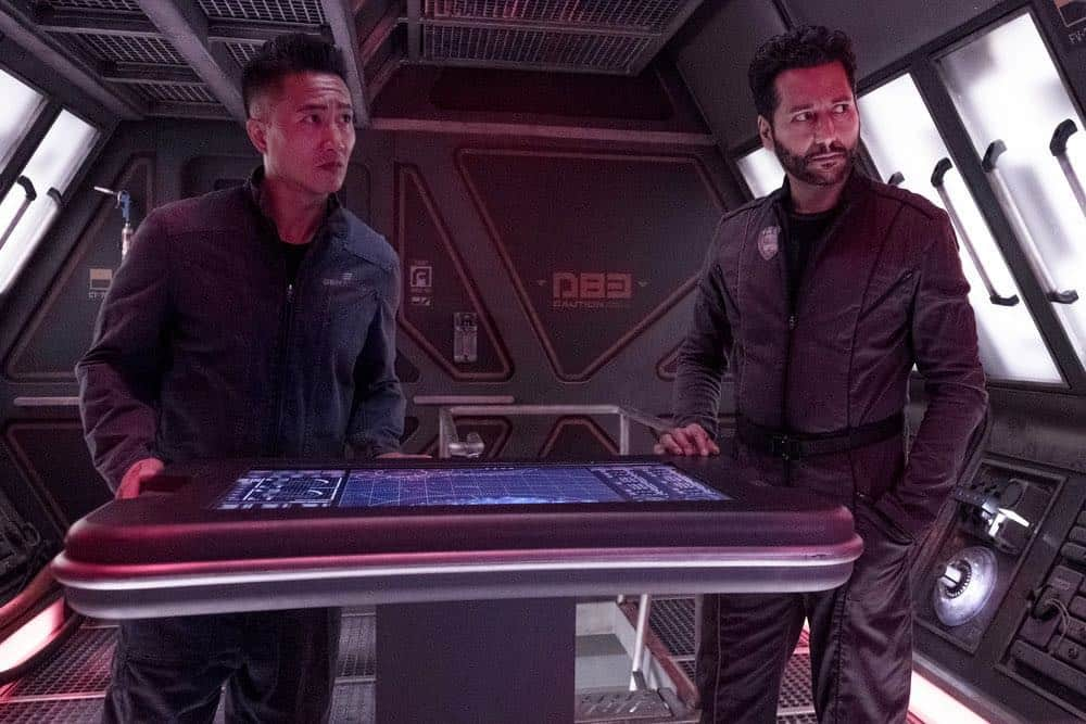 "THE EXPANSE -- ""Fight or Flight"" Episode 301 -- Pictured: (l-r) Terry Chen as Prax, Cas Anvar as Alex Kamal -- (Photo by: Rafy/Syfy)"