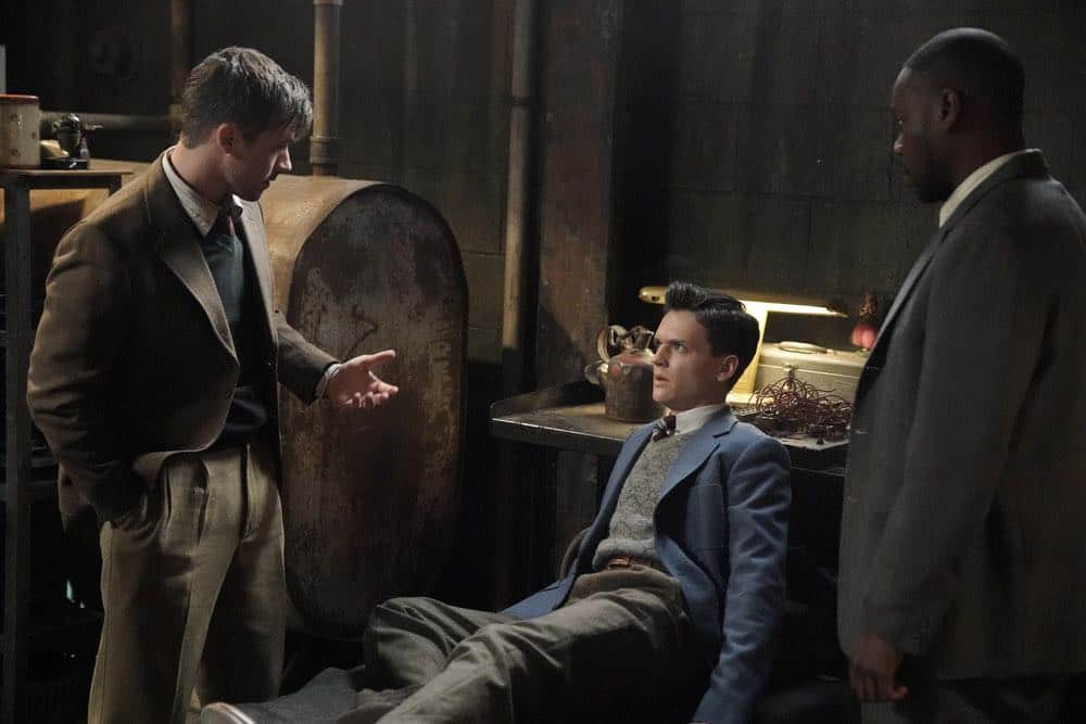 "TIMELESS -- ""The Kennedy Curse"" Episode 205 -- Pictured: (l-r) Matt Lanter as Wyatt Logan, Grant Jordan as JFK, Malcolm Barrett Rufus Carlin -- (Photo by: Paul Drinkwater/NBC)"