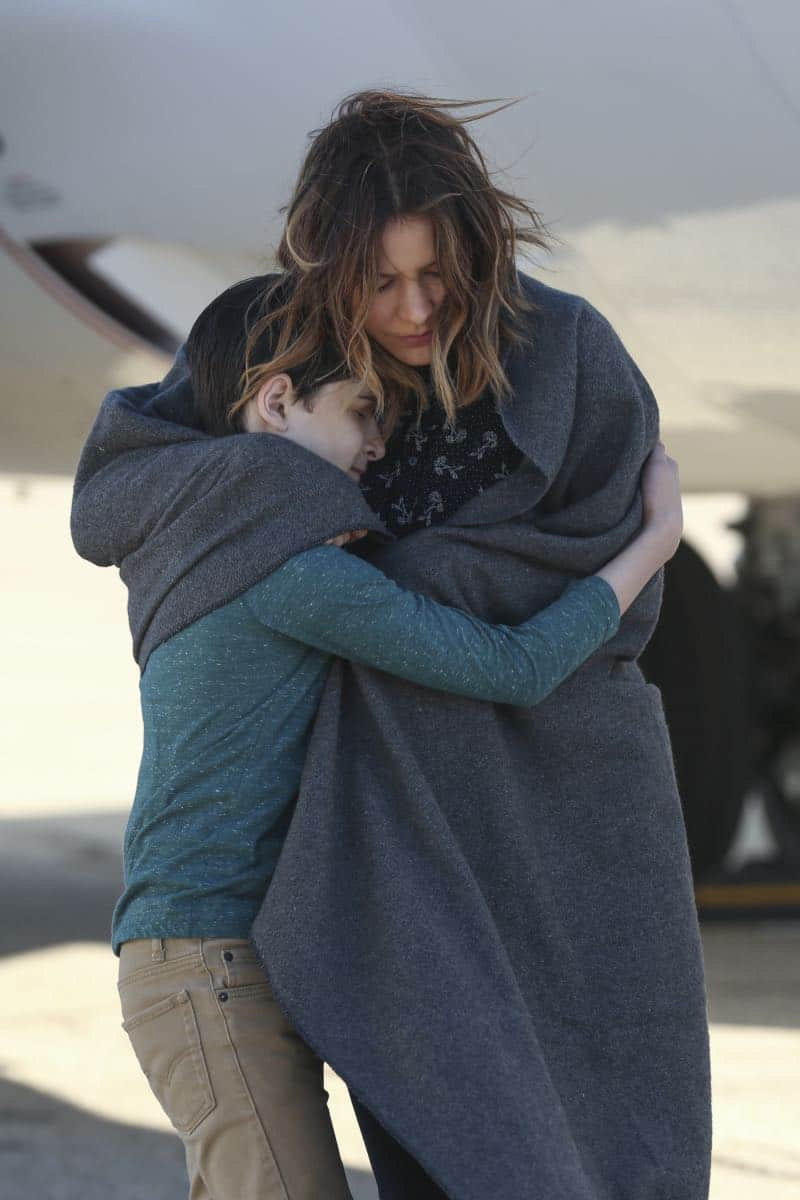 """Kenny and the Jet"" -- Paige's maternal side goes into high gear when Team Scorpion must save an unconscious, hypothermic boy stuck in the wheel well of their airborne airplane. Also, Walter's white lie to Paige starts to take a toll on him, and Paige realizes something's up, on SCORPION, Monday, April 9 (10:00-11:00 PM, ET/PT) on the CBS Television Network. Pictured: Riley B. Smith, Katharine McPhee. Photo: Michael Yarish/CBS ©2018 CBS Broadcasting, Inc. All Rights Reserved"