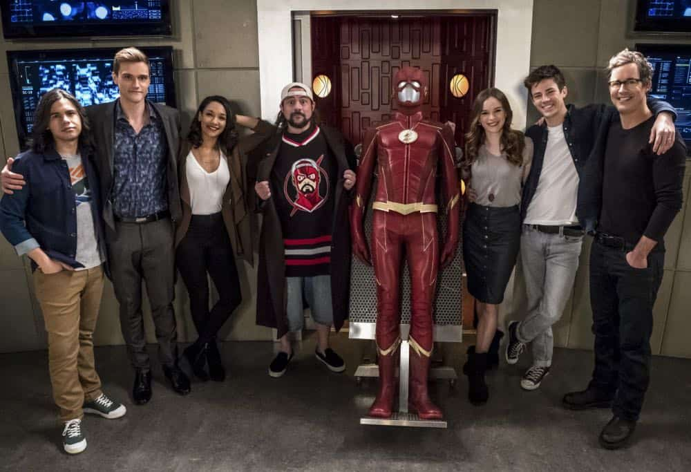 """The Flash -- """"Null and Annoyed"""" -- Image Number: FLA417a_BTS_0330b.jpg -- Pictured (L-R): Behind the scenes with Carlos Valdes, Hartley Sawyer, Candice Patton, Kevin Smith, Danielle Panabaker, Grant Gustin and Tom Cavanagh -- Photo: Katie Yu/The CW -- © 2018 The CW Network, LLC. All rights reserved"""