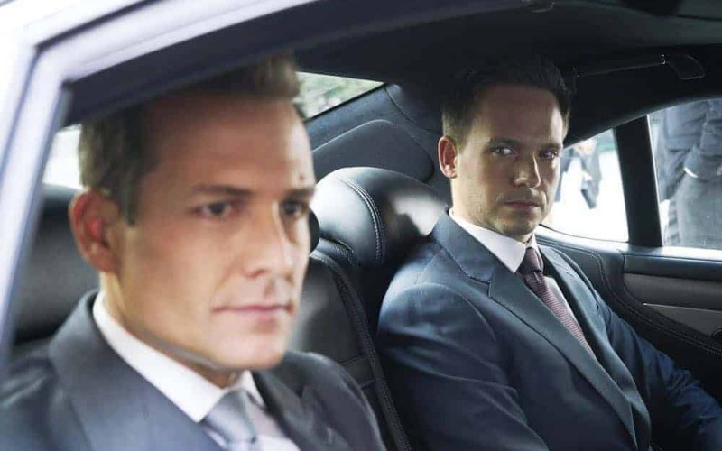 """SUITS -- """"Inevitable"""" Episode 713 -- Pictured: (l-r) Gabriel Macht as Harvey Specter, Patrick J. Adams as Mike Ross -- (Photo by: Ian Watson/USA Network)"""