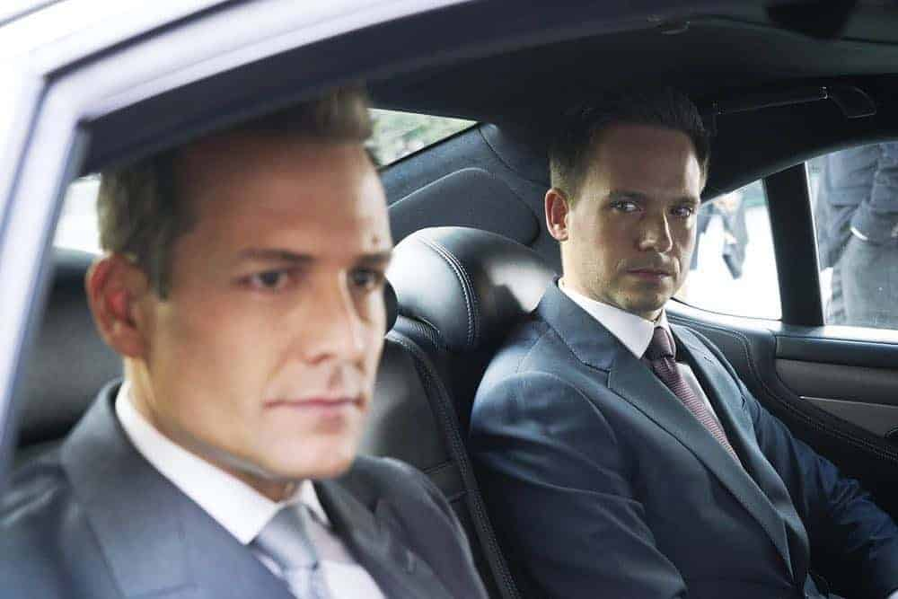 "SUITS -- ""Inevitable"" Episode 713 -- Pictured: (l-r) Gabriel Macht as Harvey Specter, Patrick J. Adams as Mike Ross -- (Photo by: Ian Watson/USA Network)"