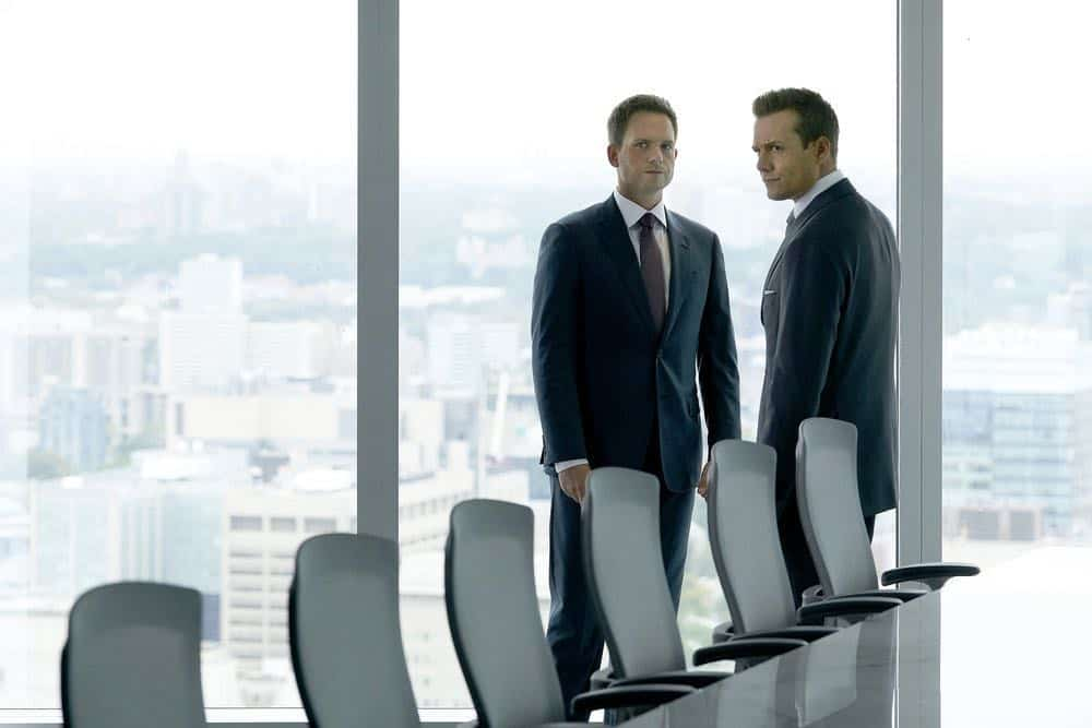 "SUITS -- ""Inevitable"" Episode 713 -- Pictured: (l-r) Patrick J. Adams as Mike Ross, Gabriel Macht as Harvey Specter -- (Photo by: Ian Watson/USA Network)"