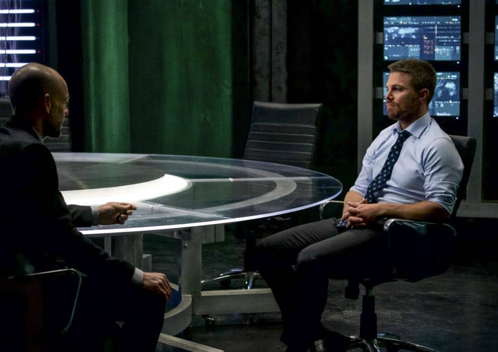 """Arrow -- """"Fundamentals"""" -- Image Number: ARR618a_0028.jpg -- Pictured (L-R): Paul Blackthorne as Quentin Lance and Stephen Amell as Oliver Queen/Green Arrow -- Photo: Shane Harvey/The CW -- © 2018 The CW Network, LLC. All Rights Reserved."""