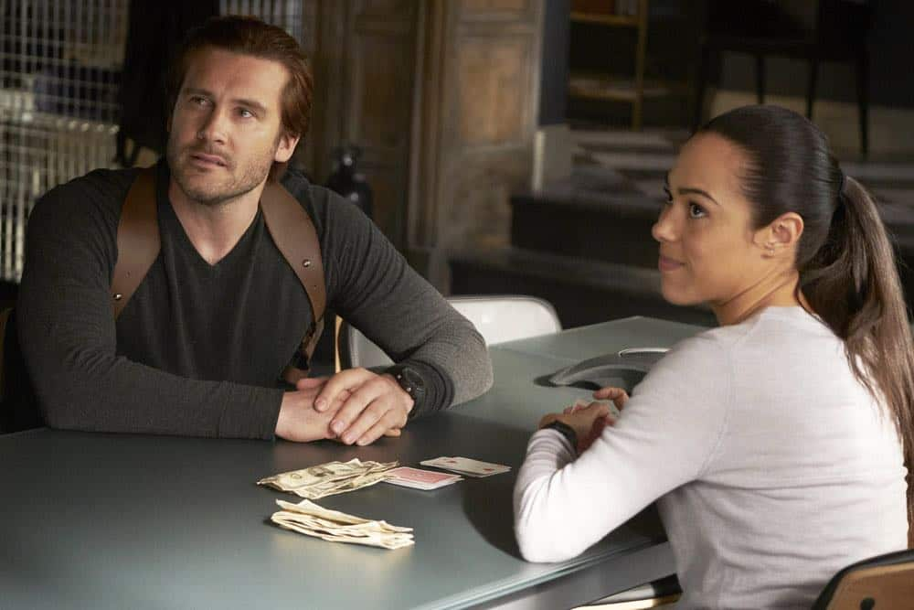 "TAKEN -- ""password"" Episode 211 -- Pictured: (l-r) Clive Standen as Bryan Mills, Jessica Camacho as Santana -- (Photo by: Christos Kalohoridis/NBC)"