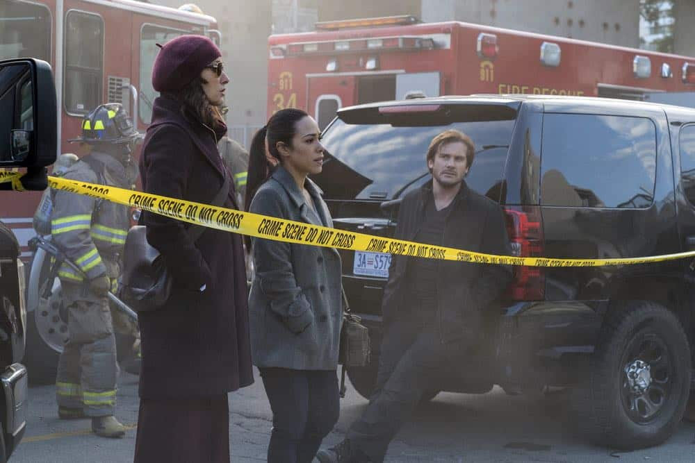 "TAKEN -- ""password"" Episode 211 -- Pictured: (l-r) Jennifer Beals as Christina Hart, Jessica Camacho as Santana, Clive Standen as Bryan Mills -- (Photo by: Panagiotis Pantazidis/NBC)"