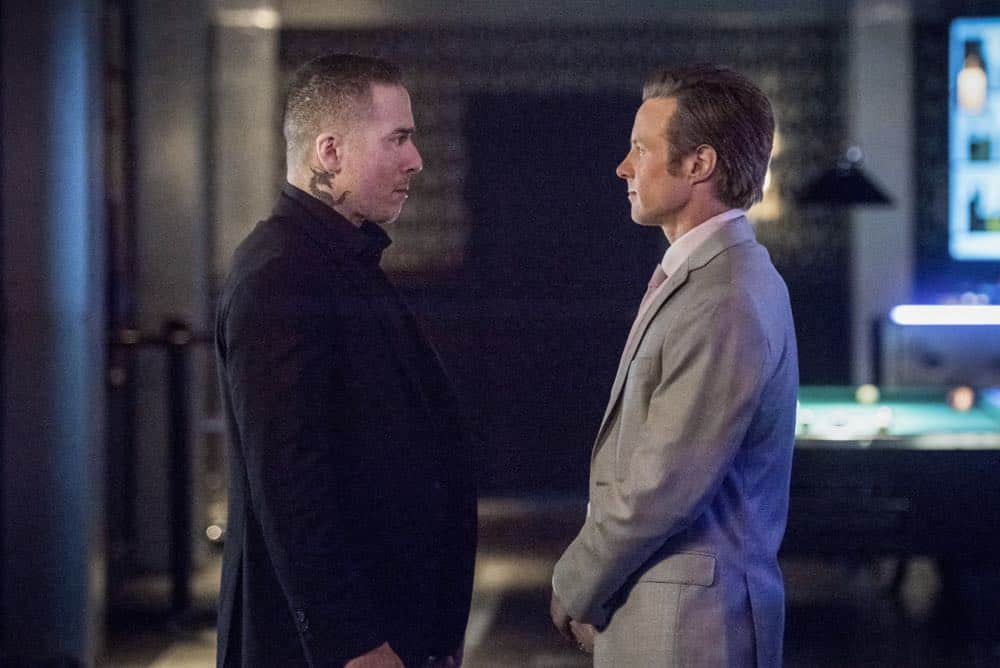 """Arrow -- """"The Dragon"""" -- Image Number: AR619a_0021.jpg -- Pictured (L-R): Kirk Acevedo as Ricardo Diaz and Ashton Holmes as Eric Cartier -- Photo: Dean Buscher/The CW -- © 2018 The CW Network, LLC. All rights reserved."""