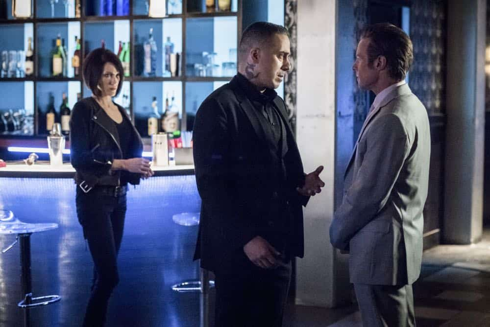 """Arrow -- """"The Dragon"""" -- Image Number: AR619a_0097.jpg -- Pictured (L-R): Katie Cassidy as Laurel/Black Siren, Kirk Acevedo as Ricardo Diaz and Ashton Holmes as Eric Cartier -- Photo: Dean Buscher/The CW -- © 2018 The CW Network, LLC. All rights reserved."""