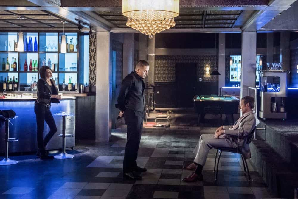 "Arrow -- ""The Dragon"" -- Image Number: AR619a_0272.jpg -- Pictured (L-R): Katie Cassidy as Laurel/Black Siren, Kirk Acevedo as Ricardo Diaz and Ashton Holmes as Eric Cartier -- Photo: Dean Buscher/The CW -- © 2018 The CW Network, LLC. All rights reserved."