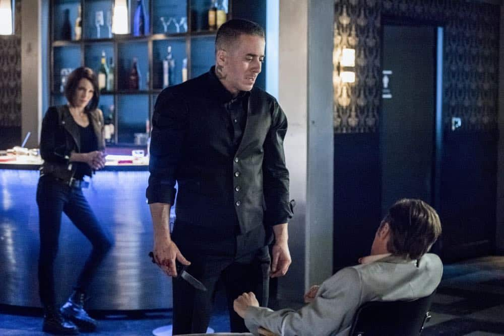 "Arrow -- ""The Dragon"" -- Image Number: AR619a_0462.jpg -- Pictured (L-R): Katie Cassidy as Laurel/Black Siren, Kirk Acevedo as Ricardo Diaz and Ashton Holmes as Eric Cartier -- Photo: Dean Buscher/The CW -- © 2018 The CW Network, LLC. All rights reserved."