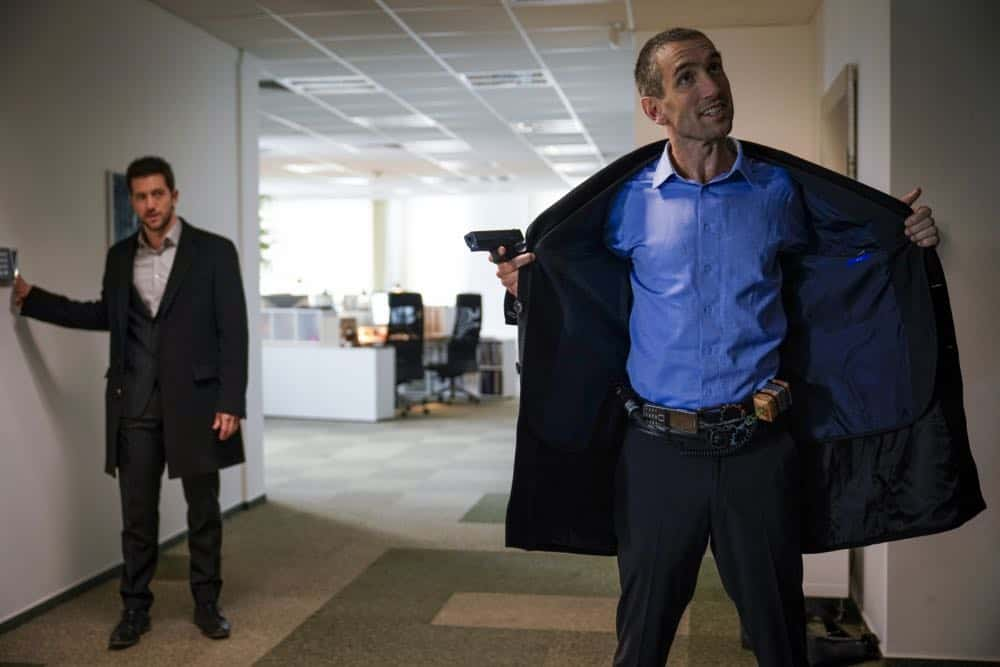 """Alters"" -- As Eric and Zara provide risk assessment services at an investment bank, they are taken hostage by a gunman targeting a low-level accountant, and Eric must negotiate for their release, on RANSOM, Saturday, April 14 (8:00-9:00 PM, ET/PT) on the CBS Television Network.  Pictured: Luke Roberts (Eric Beaumont), Gord Rand (Jordan Jones)  Photo: Dávid Lukács © 2018 Ransom Television Productions Inc."