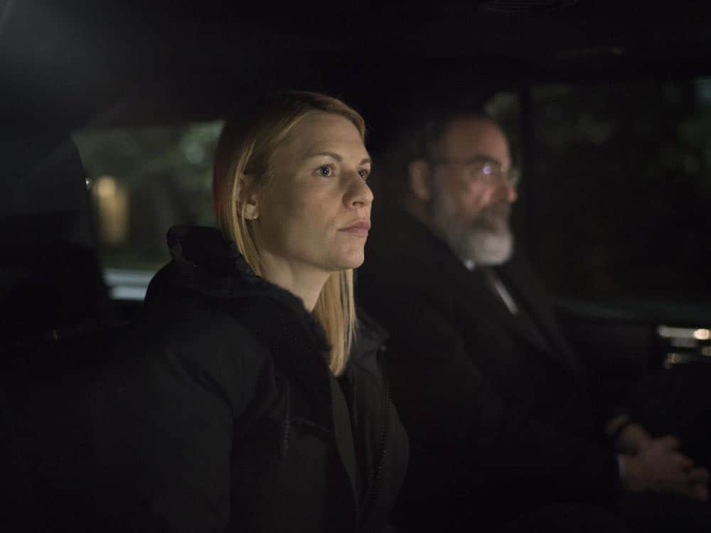 "Claire Danes as Carrie Mathison and Mandy Patinkin as Saul Berenson in HOMELAND (Season 7, Episode 10, ""Clarity""). - Photo: Antony Platt/SHOWTIME"