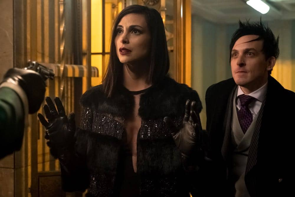 "GOTHAM: L-R: Morena Baccarin and Robin Lord Taylor in the ""A Dark Knight: To Our Deaths and Beyond"" episode of GOTHAM airing Thursday, April 19 (8:00-9:00 PM ET/PT) on FOX. ©2018 Fox Broadcasting Co. Cr: FOX"