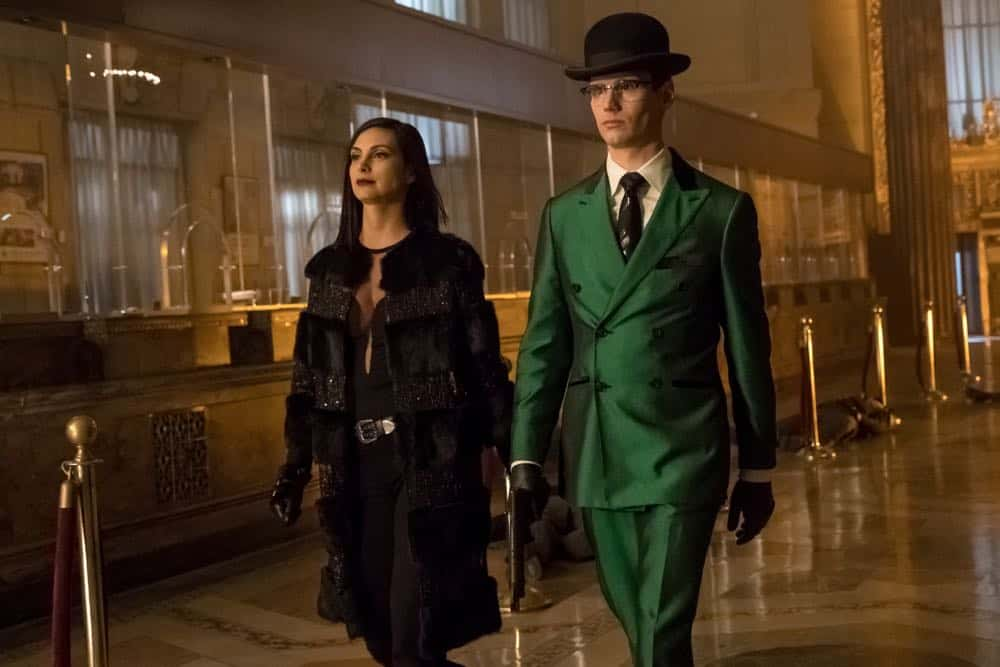 "GOTHAM: L-R: Morena Baccarin and Cory Michael Smith in the ""A Dark Knight: To Our Deaths and Beyond"" episode of GOTHAM airing Thursday, April 19 (8:00-9:00 PM ET/PT) on FOX. ©2018 Fox Broadcasting Co. Cr: FOX"