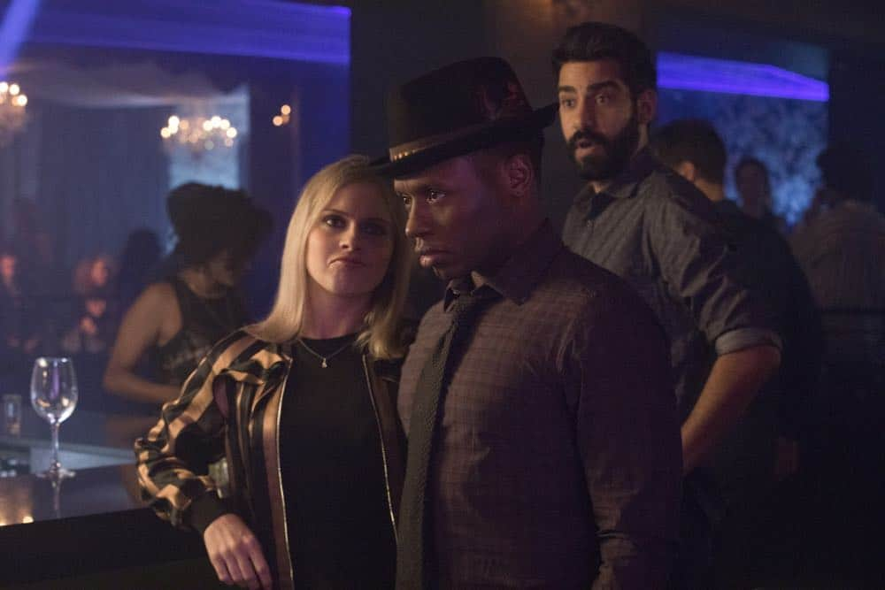 "iZombie -- ""Don't Hate the Player, Hate the Brain"" -- Image Number: ZMB407b_0195b.jpg -- Pictured (L-R): Rose McIver as Liv, Malcolm Goodwin as Clive, and Rahul Kohli as Ravi -- Photo Credit: Jack Rowand/The CW -- © 2018 The CW Network, LLC. All Rights Reserved"