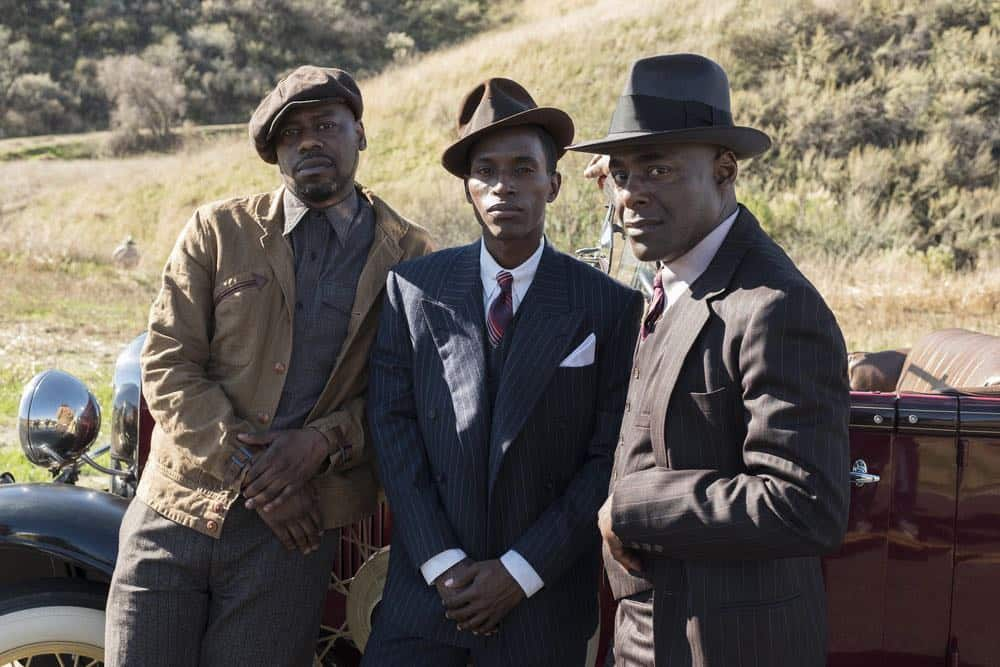 """TIMELESS -- """"King of Delta Blues"""" Episode 206 -- Pictured: (l-r) Malcolm Barrett as Rufus Carlin, Kamal Naiqui as Robert Johnson, Paterson Joseph as Connor Mason -- (Photo by: Justin Lubin/NBC)"""