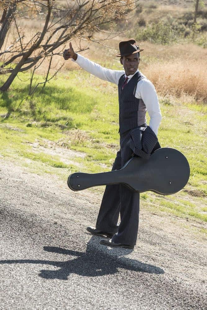 """TIMELESS -- """"King of Delta Blues"""" Episode 206 -- Pictured: (l-r) Kamal Naiqui as Robert Johnson -- (Photo by: Justin Lubin/NBC)"""