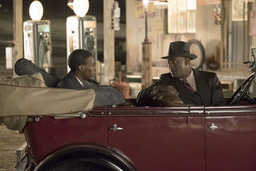 """TIMELESS -- """"King of Delta Blues"""" Episode 206 -- Pictured: (l-r) Kamal Naiqui as Robert Johnson, Paterson Joseph as Connor Mason -- (Photo by: Justin Lubin/NBC)"""