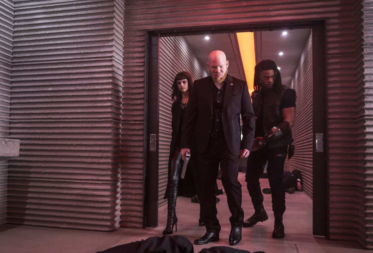 "Black Lightning -- "" Shadow of Death: The Book of War"" -- Image BLK113A_0240b.jpg Ð Pictured (L-R): Charlbi Dean Kriek as Syonide, and Marvin ""Krondon"" Jones III as Tobias and Jordan Calloway as Khalil/Painkiller -- Photo: Bob Mahoney/The CW -- © 2018 The CW Network, LLC. All rights reserved"