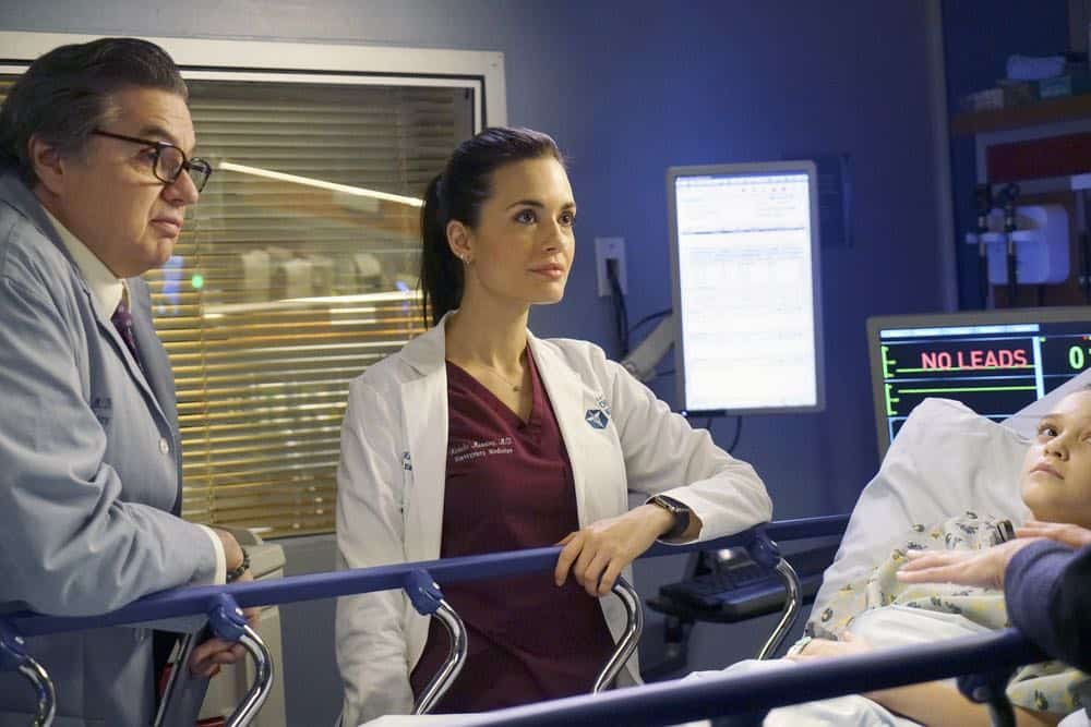 "CHICAGO MED -- ""An Inconvenient Truth"" Episode 316 -- Pictured: (l-r) Oliver Platt as Daniel Charles, Torrey DeVitto as Natalie Manning -- (Photo by: Elizabeth Sisson/NBC)"