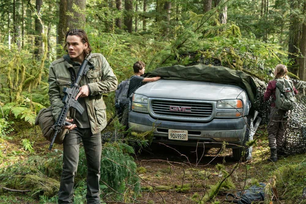 "COLONY -- ""Maquis"" Episode 301 -- Pictured: (l-r) Alex Neustaedter as Bram Bowman, Jacob Buster as Charlie Bowman, Isabella Crovetti-Cramp as Grace Bowman -- (Photo by: Daniel Power/USA Network)"