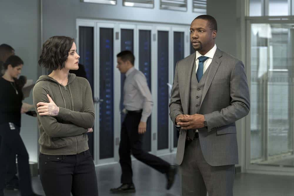 "BLINDSPOT -- ""Clamorous Night"" Episode 318 -- Pictured: (l-r) Jaimie Alexander as Jane Doe, Rob Brown as Edgar Reade -- (Photo by: David Giesbrecht/NBC/Warner Bros)"