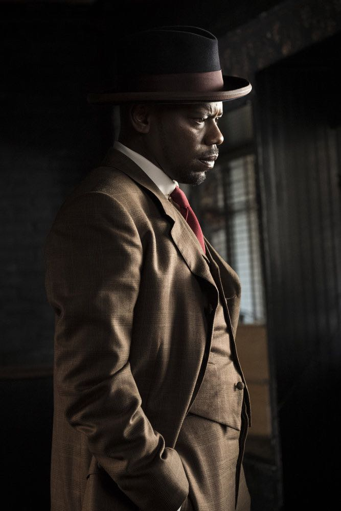 "TIMELESS -- ""Mrs. Sherlock Holmes"" Episode 207 -- Pictured: Malcolm Barrett as Rufus Carlin -- (Photo by: Justin Lubin/NBC)"
