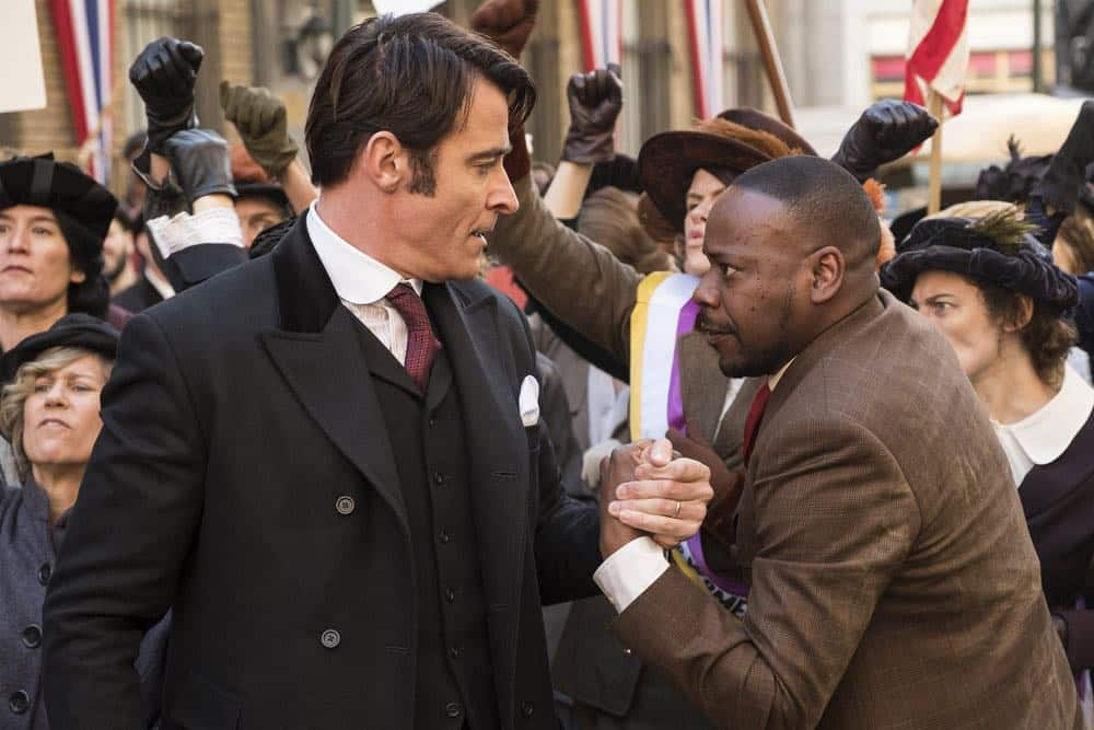 "TIMELESS -- ""Mrs. Sherlock Holmes"" Episode 207 -- Pictured: (l-r) Goran Visnjic as Garcia Flynn, Malcolm Barrett As Rufus Carlin -- (Photo by: Justin Lubin/NBC)"