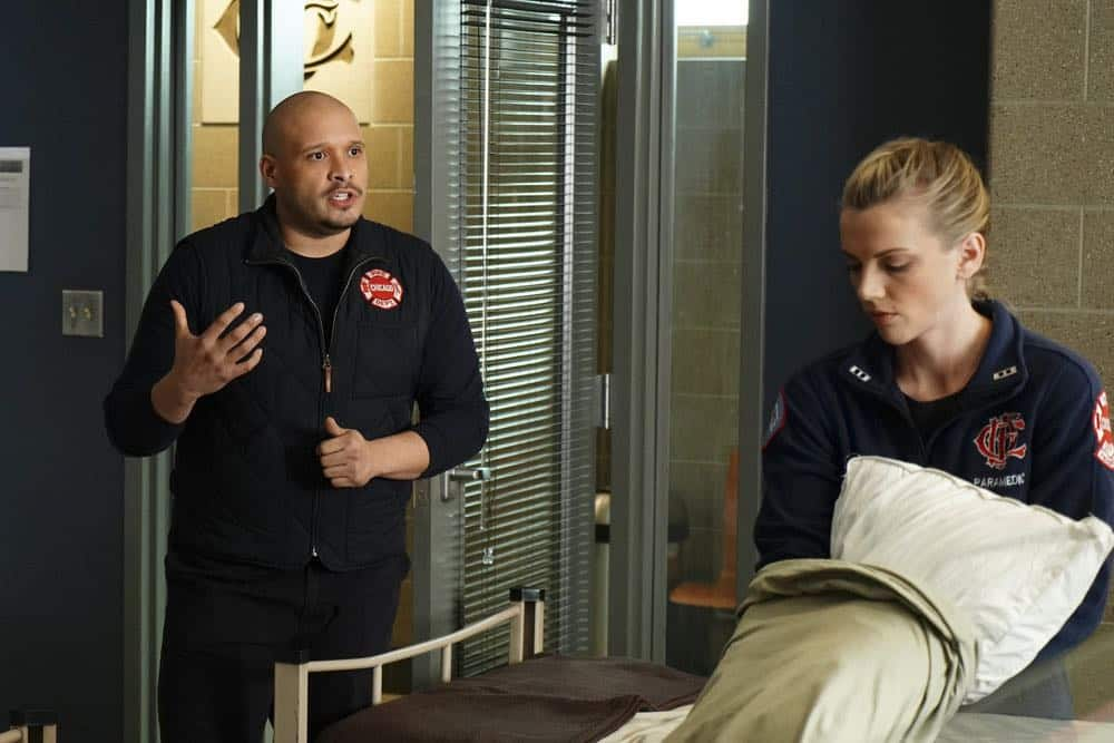 "CHICAGO FIRE -- ""The Strongest Among Us"" Episode 620 -- Pictured: (l-r) Joe Minoso as Joe Cruz, Kara Killmer as Sylvie Brett -- (Photo by: Elizabeth Morris/NBC)"