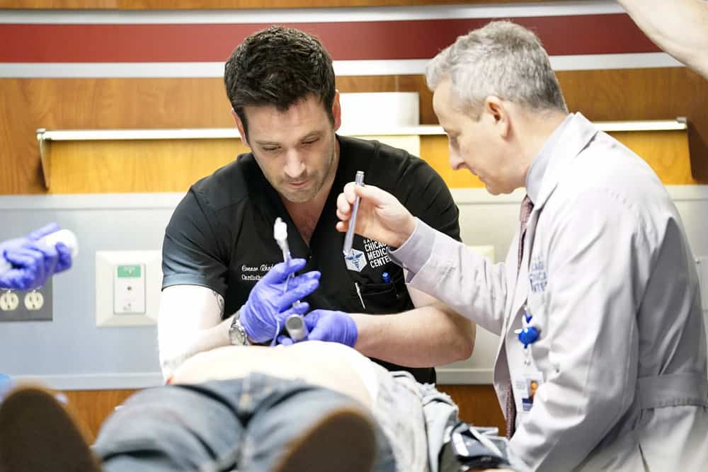 "CHICAGO MED -- ""The Parent Trap"" Episode 317 -- Pictured: (l-r) Colin Donnell as Connor Rhodes, Eddie Jemison as Dr. Stohl -- (Photo by: Elizabeth Sisson/NBC)"