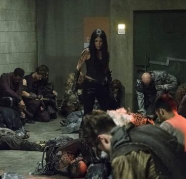 """The 100 -- """"Red Queen"""" -- Image Number: HUN502a_0224.jpg -- Pictured: Marie Avgeropoulos as Octavia -- Photo: Michael Courtney/The CW -- © 2018 The CW Network, LLC. All rights reserved."""