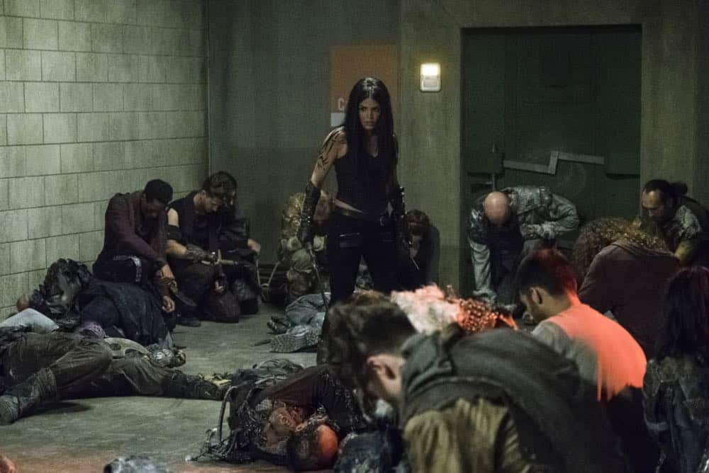 "The 100 -- ""Red Queen"" -- Image Number: HUN502a_0224.jpg -- Pictured: Marie Avgeropoulos as Octavia -- Photo: Michael Courtney/The CW -- © 2018 The CW Network, LLC. All rights reserved."