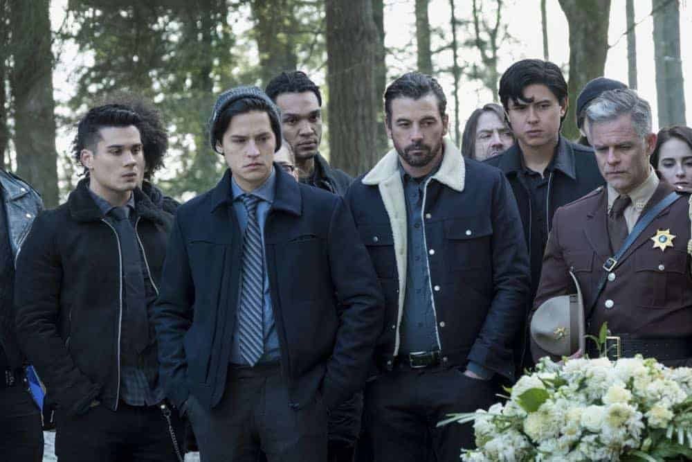 "Riverdale -- ""Chapter Thirty-Two: Prisoners"" -- Image Number: RVD219b_0138.jpg -- Pictured (L-R): Drew Ray Tanner as Fangs Fogarty, Cole Sprouse as Jughead, Skeet Ulrich as FP Jones, Jordan Connor as Sweet Pea and Martin Cummins as Sheriff Keller -- Photo: Katie Yu/The CW -- © 2018 The CW Network, LLC. All Rights Reserved."