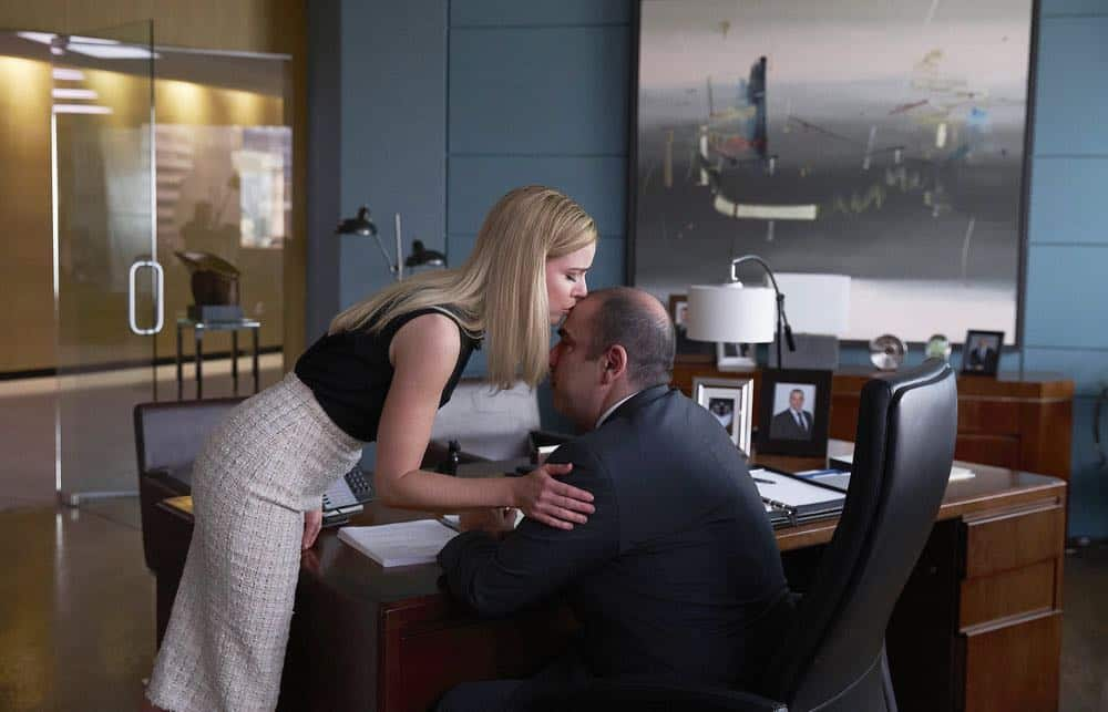 "SUITS -- ""Pulling the Goalie"" Episode 714 -- Pictured: (l-r) Amanda Schull as Katrina Bennett, Rick Hoffman as Louis Litt -- (Photo by: Shane Mahood/USA Network)"