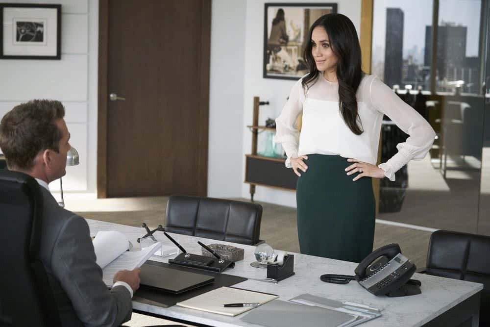 "SUITS -- ""Tiny Violin"" Episode 715 -- Pictured: (l-r) Gabriel Macht as Harvey Specter, Meghan Markle as Rachel Zane -- (Photo by: Ian Watson/USA Network)"