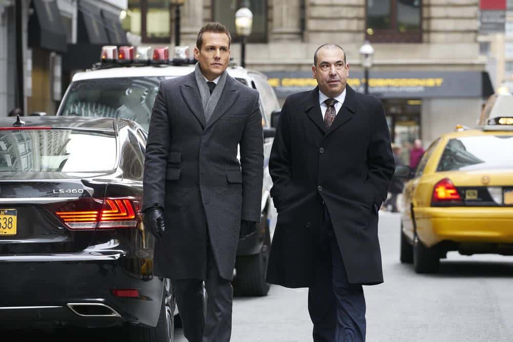 "SUITS -- ""Tiny Violin"" Episode 715 -- Pictured: (l-r) Gabriel Macht as Harvey Specter, Rick Hoffman as Louis Litt -- (Photo by: Ian Watson/USA Network)"
