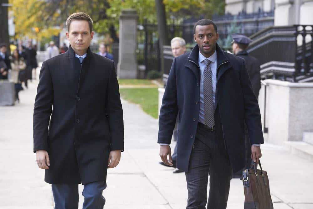 "SUITS -- ""Tiny Violin"" Episode 715 -- Pictured: (l-r) Patrick J. Adams as Mike Ross, Jordan Johnson-Hinds as Oliver -- (Photo by: Ian Watson/USA Network)"